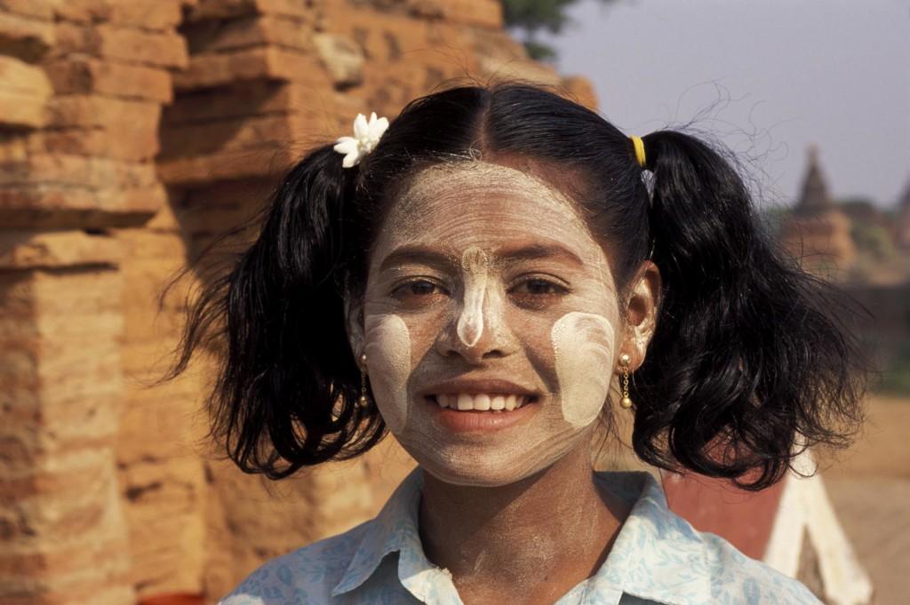 MYANMAR(BURMA), PAGAN, BURMESE TEENAGER WEARING TRADITIONAL COSMETIC PASTE TO BLEACH SKIN