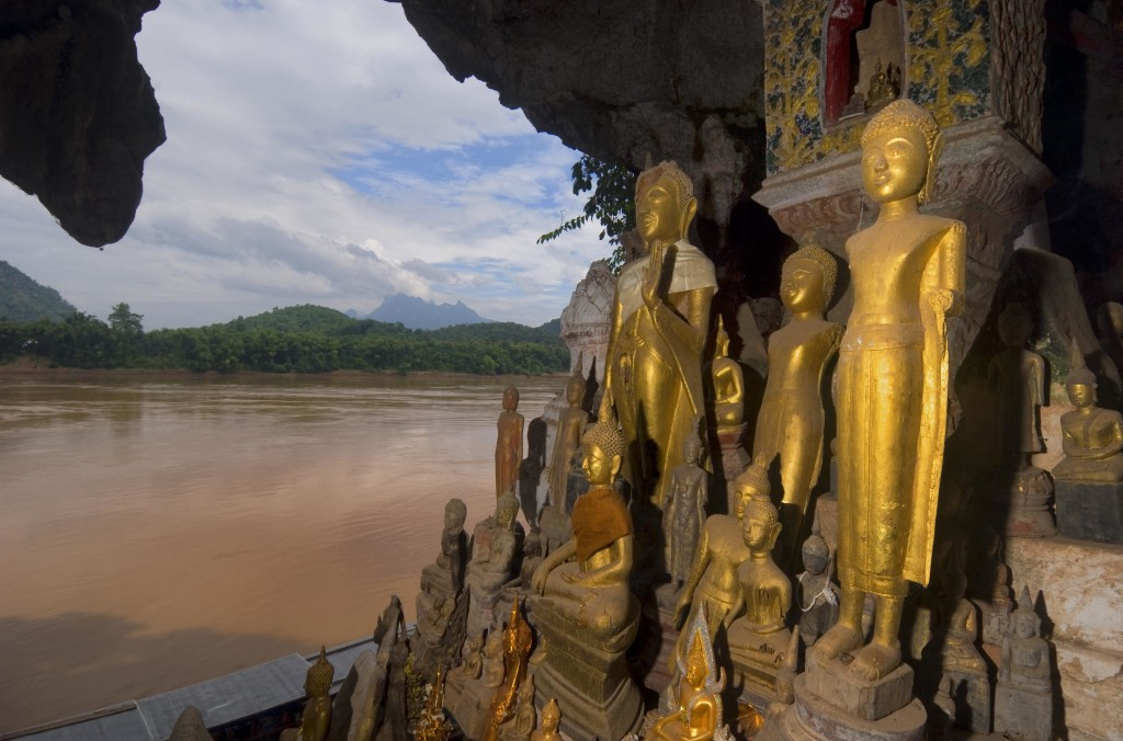 LAOS, NEAR LUANG PRABANG, MEKONG RIVER, PAK OU CAVES, BUDDHA STATUES, RIVER IN BACKGROUND